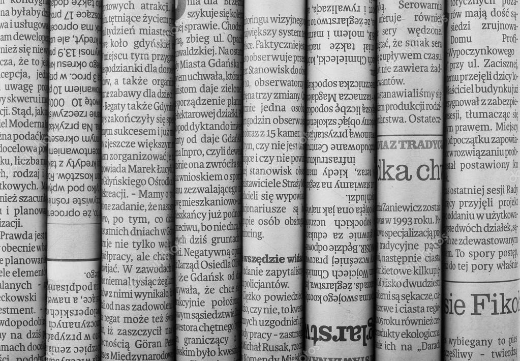 Newspaper Headlines Shown Side On In A Stack Of Daily