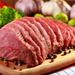 Raw beef and vegetables on wood — Stock Photo