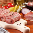 Raw beef rolls on a wooden board — Stock Photo