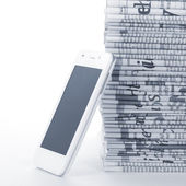 Phone and Newspapers folded and stacked concept — Stock Photo