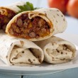 Stock Photo: Burritos wraps with meat beans and vegetables