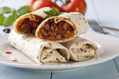 Burritos wraps with meat beans and vegetables — Stock Photo