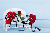 Two in love hearts on a bench. — Stock Photo