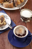 Cap of coffee with merable ring cake — Stock Photo