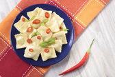 Portion of ravioli with red pepper — Stock Photo