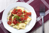Portion of ravioli with tomato sauce — Foto de Stock