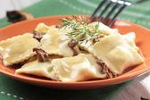 Portion of ravioli with mushrooms and sauerkraut  — Stock Photo
