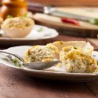 Baked eggs, stuffed with ham and parsley — Stock Photo #42246387