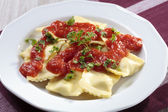 Portion of ravioli with tomato sauce — Photo