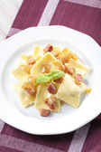 Portion of ravioli with onion and bacon — ストック写真