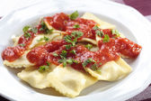 Portion of ravioli with tomato sauce — ストック写真