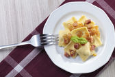 Portion of ravioli with onion and bacon — Zdjęcie stockowe