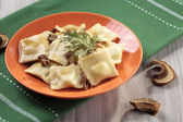 Portion of ravioli with mushrooms and sauerkraut  — Photo