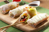 Portion of spring rolls on a bamboo board  — Stock Photo
