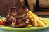 Grilled ribs on plate — Stock Photo
