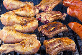 Sausage, raw ribs and chicken with barbecue — Stock Photo