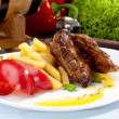 Grilled ribs on plate — Stock Photo #49750825