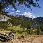 Tourist watching mountains panorama — Stock Photo #27549571