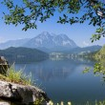Lake in mountains panorama — Stock Photo #27549945