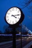Clock in the night — Stock Photo
