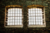 Old windows with bars — Stock Photo