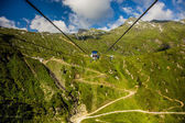 Chair lift in the mountains — Stock Photo