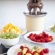 Kebabs with pieces of strawberry, mandarin and kiwi , fruit skewers  — Foto de Stock