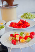 Kebabs with pieces of strawberry, mandarin and kiwi , fruit skewers — Stock Photo