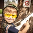 Boy Playing with Toy Crossbow Gun — Stock Photo