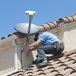 Satellite Installer on Roof — Stock Photo #28228213