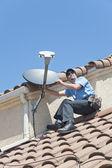 Satellite Installer on Roof — Stock Photo