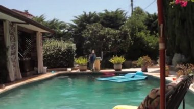 Boy Jumping Into Pool — Stock Video