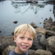 Boy Exploring on the Rocks at the Harbor — Stock Photo