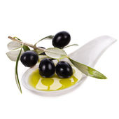 Black olives in olive oil on white background — Stock Photo