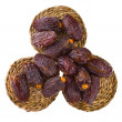 Dried dates in small circular mats — Stock Photo