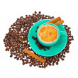 Stock Photo: Coffee beans, green ceramic cup of freshly brewed coffee