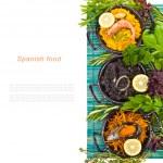 Spanish Mediterranean sea food - black rice, paella, noodles — Stock Photo