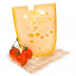 Foto Stock: Emmental cheese piece decorated with cherry tomatoes