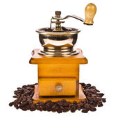 Coffee beans and vintage coffee mill isolated on white background — Stock Photo
