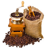 Bag of coffee beans and old coffee mill — Stock Photo