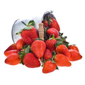 A lot of fresh strawberries and a pail . Isolated on a white background. — Stock Photo