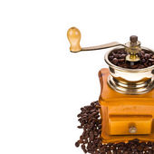 Coffee beans and vintage coffee mill — Stock Photo