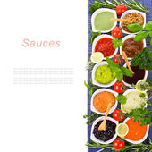 Fresh vegetables and herbs and cooking sauces — Stock Photo