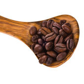 Coffee beans on a wooden spoon — Stock Photo