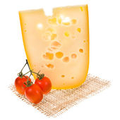 Emmental cheese piece decorated with cherry tomatoes — Stock fotografie