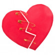 Two halves of the heart fastened with pins. cut out of paper isolated on white background — Stock Photo #28343351