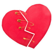 Two halves of the heart fastened with pins. cut out of paper isolated on white background — Stock Photo