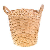 Soybeans in a wicker basket, isolated on white background — Stock Photo