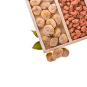 A set of dried fruit - figs and candied almonds. in a wooden box. isolated on white background — Stock Photo