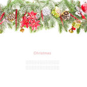 Merry Christmas edge of the branches of Christmas tree with decorations isolated on white background — Stock Photo